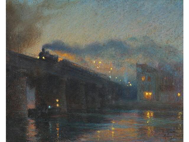 Train dans la nuit sur un pont